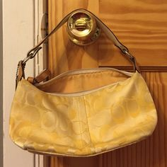 Yellow coach logo purse In great shape! Inside could use a spot clean but is otherwise in great shape. Small dirt spot on outside corner Coach Bags Shoulder Bags