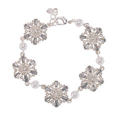 The Sparkling Winter Snowflake Collection features silvertone with pearlesque and rhinestone accents.FEATURES• Rhinestone embellished snowflake charms connected together with a faux pearl in between each charm• Lobster claw claspMATERIALS• Antique silvertone plating• Plastic (acrylic)• Quartz• Brass• Glass• Zinc