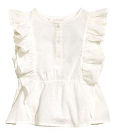 White. Blouse in airy cotton dobby-weave fabric. Buttons at top, short ruffled sleeves, and elasticized seam at waist.