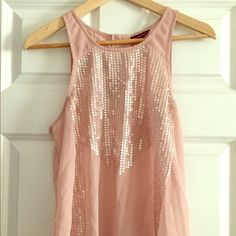 Pink sheer tank with sequins Lovely sheer blush pink tank with sequins that looks killer with skinny jeans and a good pair of heels for a night on the town, or with shorts and sandals during the day. Dress it up or down with accessories, it's very versatile! American Eagle Outfitters Tops Tank Tops