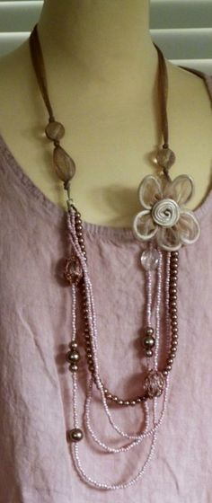 Light pink and rose bead necklace with beautiful flower detail, fabric fastener