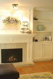Image result for built in cabinetry around windows and fireplace