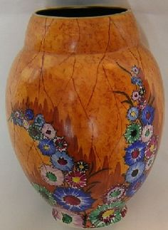 A Carlton Ware Garden pattern vase, number 3501, coloured in burnt orange and decorated with bright daisy-like flowers in various colours.