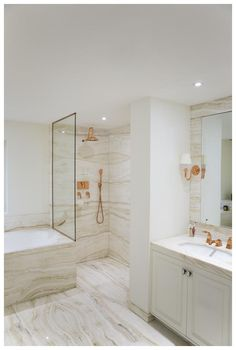 Copper finishes and fixtures in a bathroom designed by UK Interior Designer Katharine Pooley.