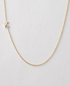 Asymmetrical initial necklace ($220)