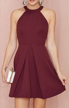A maroon cocktail dress for an evening at a delicious restaurant and a show.
