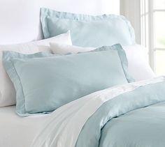 Light blue duvet with ocean accents and white furniture for crisp, open bedroom: Linen Duvet Cover  Sham - Porcelain Blue #potterybarn