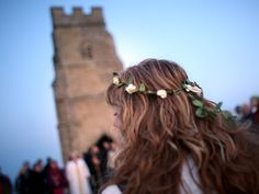 While hundreds of people across the world gather to protest on May Day, a more serene sight can be found at Glastonbury Tor where crowds came together to for the Beltane dawn celebrations. The druid festival marks the start of summer was and conducted by Rollo Maughfling, the Archdruid of Glastonbury and Stonehenge.