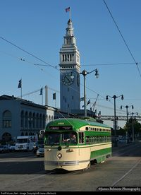 MUNI car 1051 heads west along the Embarcadero at the Ferry Building in San Francisco. This PCC streetcar was built by St. Louis Car Co. in 1948, and is painted to honor the San Francisco Municipal Railway (with the simplified 1960s livery).