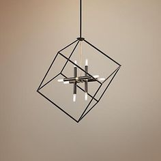 The open frame cube cages this contemporary pendant with airy style.