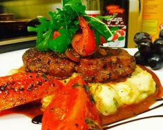 Dinner tonight  Fillet mignon  or ribeye yuo have choice With Italian garlic mushpotatoes , & satte Roma tom. Glaze on the top (Brown) gravy Continental kitchen  By Sebascocina  Money back garantee !!!!!