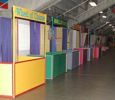 """carnival games booths lineup I like how each is different color scheme with name of game. we could """"frame"""" it out of foam board or cardboard painted with either same material below or just table cloth attached to wall to hang"""