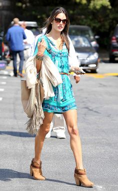 Alessandra Ambrosio in a printed Ella Moss dress, brown booties and a fabulously fringed bag.