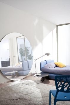 Blue and white modern bedroom ...love the mirror, looks like a portal to another dimension
