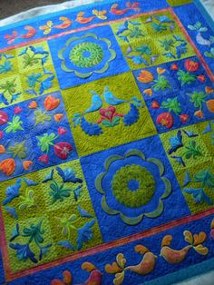 Look at the colors in this applique quilt! Longarm quilted by:Sew Kind Of Wonderful: Finished!