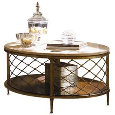 "Athene Coffee Table from the Classic Brownstone event at Joss and Main.  Product: Coffee table  Material: Wood, metal and stone  Finish: Corsica  Features: Transitional style  Dimensions: 19.25""H x 48""W x 34""D  Retail $2499. This Event $1947.  T's NOTE: All Round coffee tables. & accent tables tend to be expensive. Why? What is a Corsica finish?  I like the bottom shelf on this table plus the design of the lattice-like metal."