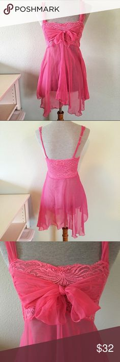 Vintage Victoria's Secret Babydoll Slip vintage victoria's secret hot pink babydoll slip. one of the most gorgeous pieces in my collection! completely sheer with a lace bodice which is see through lace. has two sheer ribbons which i tied into a bow across the bust. could be pulled to the back or front. falls beautifully on your body. has adjustable straps. in absolute pristine vintage condition. no size tag, would fit a small best. my mannequin's measurements are 34-26-35. this item is…