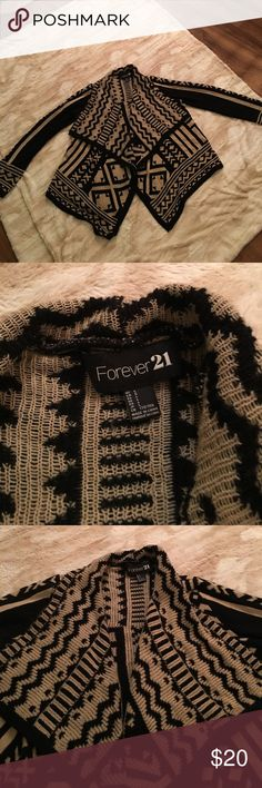 Forever 21 aztec sweater Forever 21 aztec sweater. This is my fave sweater still has much love to give!!! I like to pair this with a black tank and dark skinny jeans or awesome black leggings  also knee high or ankle boots super cute for fall or winter Forever 21 Sweaters Shrugs & Ponchos