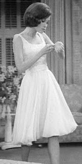 Laura Petrie (aka Mary Tyler Moore) had a great wardrobe. I am in love with this dress. I love how the skirt flows (probably silk chiffon) and the top has delicate, but sparkling beading. They don't make them like this anymore, feminine yet modest.