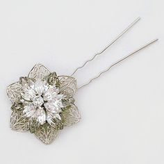 Cheryl King Couture Bridal Hair Accessories. Vivian filigree bridal hair pin has two layers of marquis crystal flower designs.  Wear one or several to create your wedding day sparkle.