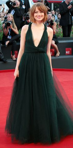 Emma Stone swept onto the red carpet at the Birdman premiere at the 2014 Venice Film Festival in a beautiful forest green tulle Valentino gown, styled with barely any accessories, save for delicate rings from Graziela Gems and EF Collection. #InStyle