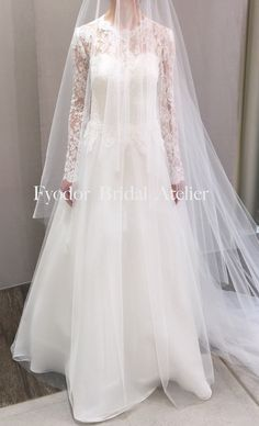 Fyodor Bridal Atelier stunning bridal dress! French lace, silk, long sleeves.