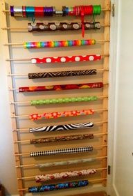 behind door storage for giftwrap!  THIS is such a GREAT idea!  Giftwrap is so expensive and mine always ends up mangled in the corner of a closet!  Love this idea but I can see my baby loving this!   :(