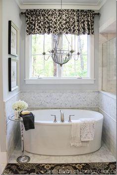 Tub bath with grey herringbone backsplash. 2015 Birmingham Parade of Homes