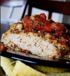 /2 cup Italian bread crumbs (or flour) 2 eggs, beaten 4 boneless, skinless chicken breasts 1/4 cup grated parmesan cheese 1/4 cup crushed garlic croutons 1 tablespoon butter, melted 2 large tomatoes 3 tablespoons minced fresh basil 2 garlic cloves, minced (appox. 1 teaspoon) 1 tablespoon olive oil salt & pepper to taste