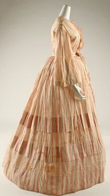 Dress  ca. 1850. It now appears to be a pale peach colour but I suspect it used to be a much more vibrant colour. When I see these pale ones though I have to admire the women who did the laundry in the house.