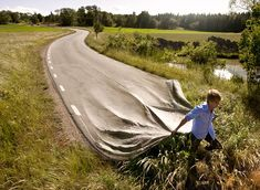 Nicely done image of someone pulling a road. What does this mean? Perhaps taking charge of your path? Or dragging the past?