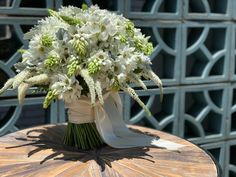 Let you bouquet speak for itself! This stunner of all white blooms is sculptural and unique... Made in Memphis!!!