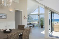 Weitblick - Apartment with sea view, terrace and internet (WLAN) in Scharbeutz - MoinFewo Hotel Apartment, Kitchen Remodel, Beach House, Places To Go, Dining Table, Ceiling Lights, Vacation, Living Room, Outdoor Decor