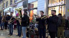 People having fun on the streets of Malaga + street concert, Spain