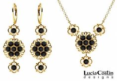 Feminine Necklace and Earrings Set by Lucia Costin with Filigree Elements and Cute Flowers, Set with Black Swarovski Crystals; 14K Yellow Gold over .925 Sterling Silver; Handmade in USA Lucia Costin. $124.00. Lucia Costin floral jewelry set. Style takes wings in this lovely jewelry set that have a graceful flower shape. Flowers and fancy ornaments beautifully combined. Embellished with black Swarovski crystals. Handmade in USA unique jewelry set