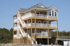 South Nags Head Vacation Rental: Livin The Dream 735 |  6 beds | small living room  | ok rec room  |   Can't figure out which way decks face   |  It would be tight   |  $4700