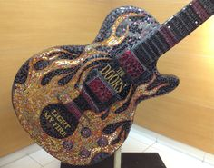 Gorgeous Mosaic for the Garden Wall. This fiery mosaic guitar homage to The Doors is by Robin Bott and it's wonderful to see this intricately decorated tall Gibson Les Paul in honor of Robby Krieger's exquisite work. Have one custom made! Regency House, Hollywood Homes, Morrisons, Gibson Les Paul, Jim Morrison, Bohemian Style, Mosaic, Interior Decorating, It's Wonderful