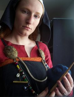 Amanda Marksdottir with spindle and wool. https://www.flickr.com/photos/ragnvaeig/4728738146/in/photostream/