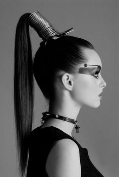 High ponytail and really cool make up