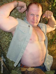 a rancher daddy cowboy shirtless flexing muscles