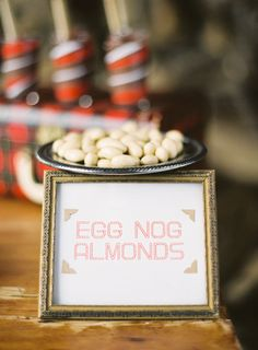 candied almonds = Italian tradition which is a sign of good luck and wishes. Egg nog adds 'festive' twist