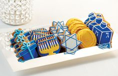 Blue, White, and Gold decorated Hanukkah cookies.