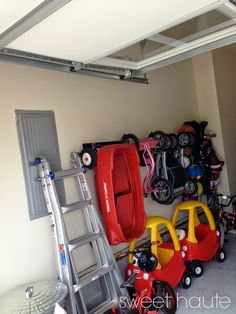 Storage for skateboards, balls, wagon radio flyer, cozy coupe, stroller, bikes for children, plus Garage Floor Paint Epoxy Tutorial: SWEET HAUTE kids toy rack, storage ideas. Pin now....read later!