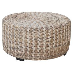 Bring coastal appeal to your home with this woven abaca coffee table, featuring a wood frame and natural finish.    Product: Coffee...