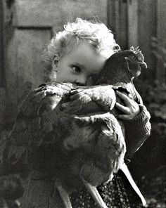 Bethany Holding Chicken ... photographed by Nell Dorr, from the book 'Mother and Child'.