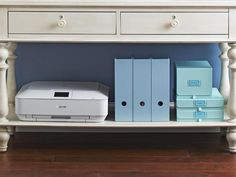 Save the bottom ledge for bulkier things like a printer and magazine files.