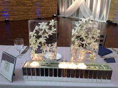 Formal Modern Classic  // reception table centerpieces with submerged orchids