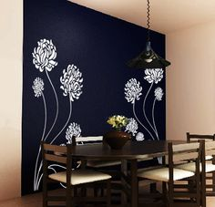 navy accent wall with tan on the rest. i think i might do this over summer, minus those ugly flowers