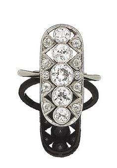 A diamond plaque ring, circa 1920 The elongated oval openwork plaque, millegrain-set throughout with old brilliant and single-cut diamonds, diamonds approx. 1.85cts total