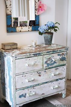 White distressed dresser with an hint of blue